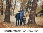 two boys standing in the park... | Shutterstock . vector #640269754