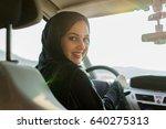 happy muslim woman driving car | Shutterstock . vector #640275313