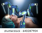 surgery performed by robotic arm | Shutterstock . vector #640287904