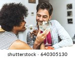 young cheerful couple drinking...   Shutterstock . vector #640305130