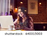 happy woman using laptop and...   Shutterstock . vector #640315003