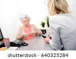 mature female doctor hearing... | Shutterstock . vector #640325284