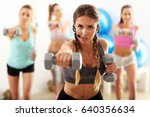 Small photo of Group of smiling people doing aerobics