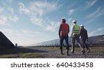 technician walks with workman... | Shutterstock . vector #640433458