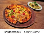 italian pizza on tray and pasta | Shutterstock . vector #640448890