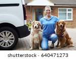 Stock photo portrait of woman running dog walking service 640471273