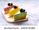 three colorful cheesecake on... | Shutterstock . vector #640476280