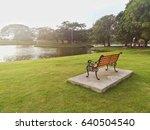 wooden bench in public park   Shutterstock . vector #640504540