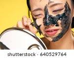 a korean woman in a black mask... | Shutterstock . vector #640529764