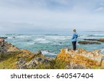 female tourist hiking along... | Shutterstock . vector #640547404