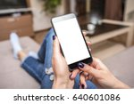 woman using phone with copy... | Shutterstock . vector #640601086