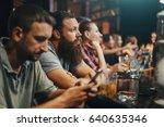 bearded man in crowded bar... | Shutterstock . vector #640635346