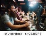 solemn bearded man smoking... | Shutterstock . vector #640635349