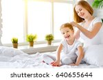 cute mother combing hair... | Shutterstock . vector #640655644