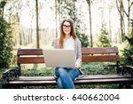 young woman with a laptop on a... | Shutterstock . vector #640662004