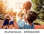 four basketball players have a... | Shutterstock . vector #640666360