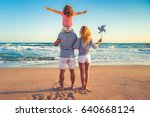 happy family on the beach.... | Shutterstock . vector #640668124