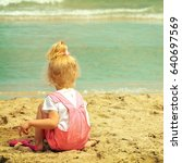 baby girl playing in the sand... | Shutterstock . vector #640697569