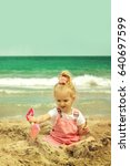 baby girl playing in the sand... | Shutterstock . vector #640697599