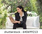 business women holding teblet... | Shutterstock . vector #640699213