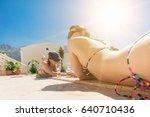 Two Women In A Bikini With A...