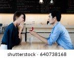 asian man showing an engagement ... | Shutterstock . vector #640738168