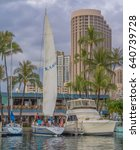 Small photo of Honolulu, Hawaii, USA, May 15, 2017: Young Polynesian men and women ready a racing sloop for an evening race in Waikiki.