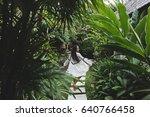 Woman Walking In Tropical...