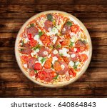 pizza salami on the  wooden...   Shutterstock . vector #640864843