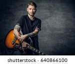handsome young acoustic guitar... | Shutterstock . vector #640866100