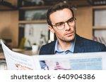 serene male reading newspaper...   Shutterstock . vector #640904386