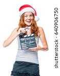 Small photo of A young actress with a beater of cinema wears a Santa hat