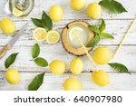 lemon with lemonade on wooden... | Shutterstock . vector #640907980