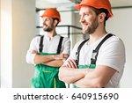 happy workmen glancing with...   Shutterstock . vector #640915690