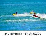 Three Men Are Riding A Ski...