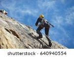 climber climbs on the rock wall ... | Shutterstock . vector #640940554