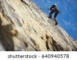 climber climbs on the rock wall ... | Shutterstock . vector #640940578