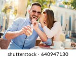 flirting in a cafe. beautiful... | Shutterstock . vector #640947130