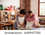 mixed race couple using laptop... | Shutterstock . vector #640947700
