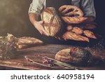 variety of bread hold men's...   Shutterstock . vector #640958194