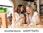 cheerful mature women enjoying... | Shutterstock . vector #640975693