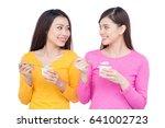 two young beautiful woman... | Shutterstock . vector #641002723