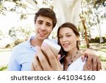 young couple in the park | Shutterstock . vector #641034160