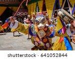 Monk Raising His Drum At...