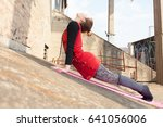 young woman doing yoga outdoors | Shutterstock . vector #641056006