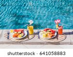 two plates with fresh fruit and ... | Shutterstock . vector #641058883