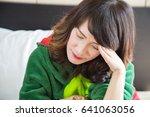asian girl headache because she ...   Shutterstock . vector #641063056
