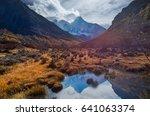 beautiful golden snow mountain  ... | Shutterstock . vector #641063374