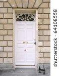 White Front Door Of A Georgian...