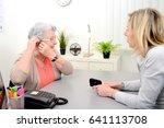 mature female doctor hearing... | Shutterstock . vector #641113708